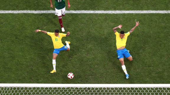 Neymar stretches for a cross to score Brazil