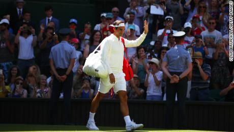 LONDON, ENGLAND - JULY 02:  Roger Federer of Switzerland walks out onto the court ahead of his Men's Singles first round match against Dusan Lajovic of Serbia on day one of the Wimbledon Lawn Tennis Championships at All England Lawn Tennis and Croquet Club on July 2, 2018 in London, England.  (Photo by Clive Brunskill/Getty Images)