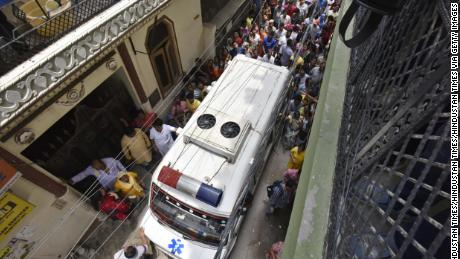 An ambulance is seen exiting the scene of the alleged murder, in Burari, a predominately low-income neighborhood in North Delhi.