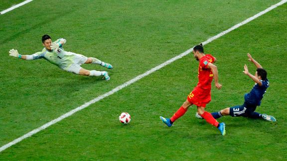 Chadli slides the ball past Japan goalkeeper Eiji Kawashima to finish off Belgium