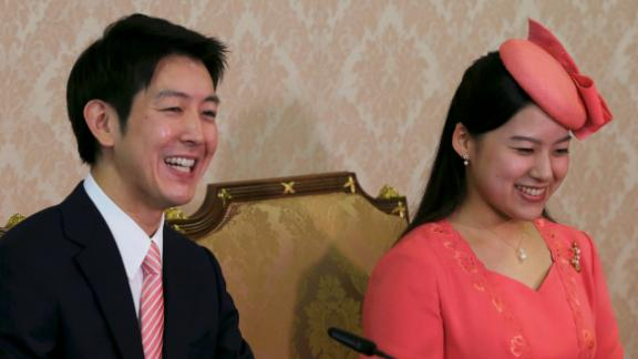 Japanese Princess Ayako, the third daughter of the late Prince Takamado, and her fiancé Kei Moriya attend a news conference to announce their engagement at the Imperial Household Agency in Tokyo on July 2, 2018.