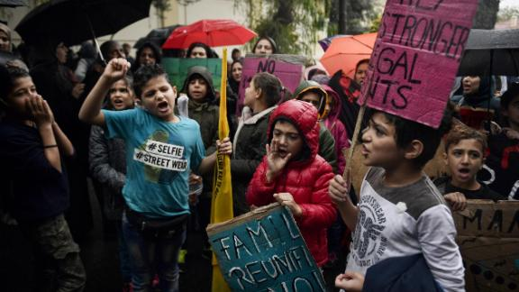 Refugee children protest outside the German embassy in Athens on November 8, 2017, to demand a faster family reunification process in Germany.
