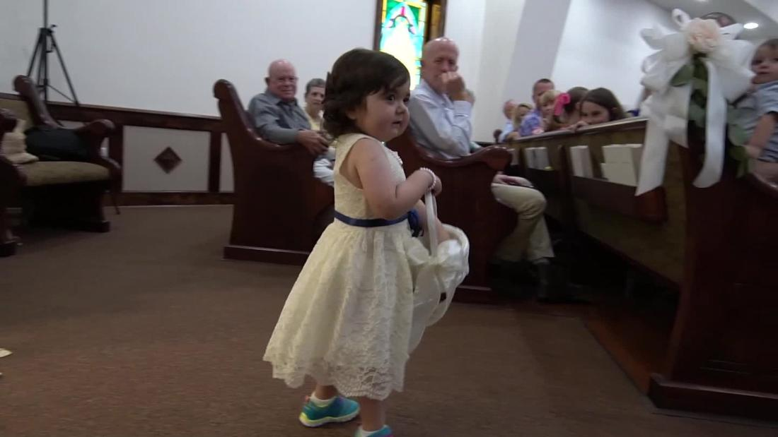 A 3-year-old cancer survivor served as a flower girl in her bone marrow donor's wedding