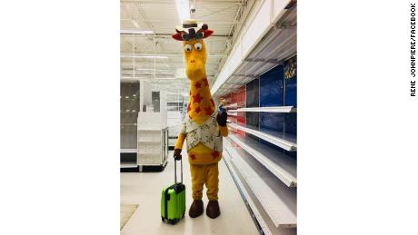 Geoffrey the Giraffe prepares to leave an empty Toys 'R' Us store.