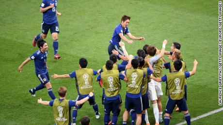 3afed046e Genki Haraguchi of Japan celebrates with teammates after opening the  scoring against Belgium.