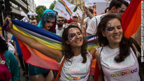 People take part in the annual Pride in London parade on June 27, 2015.