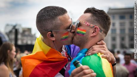 A couple kiss during London's annual Pride Parade, which has been canceled this year due to the coronavirus pandemic.
