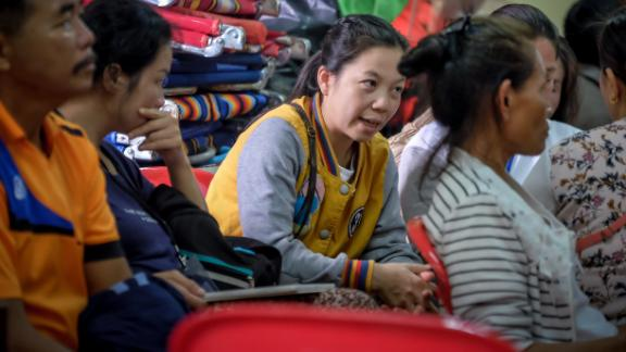 Relatives of the stranded children and their coach gather at Khun Nam Nang Non Forest Park to hear updated news on the rescuse efforts on Tuesday morning.