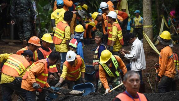 Workers fix the road leading to Tham Luang cave in Khun Nam Nang Non Forest Park following news all members of children's football team and their coach were alive in the cave in Mae Sai district on July 3, 2018. - Food and medical help reached 13 members of a Thai youth football team found rake thin but alive, huddled on a ledge deep inside a flooded cave nine days after they went missing, as the focus turned on July 3 to how to get them out. (Photo by Lillian SUWANRUMPHA / AFP)        (Photo credit should read LILLIAN SUWANRUMPHA/AFP/Getty Images)