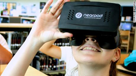 A student tries on a virtual reality headset.