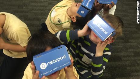 Children use Nearpod VR headsets.