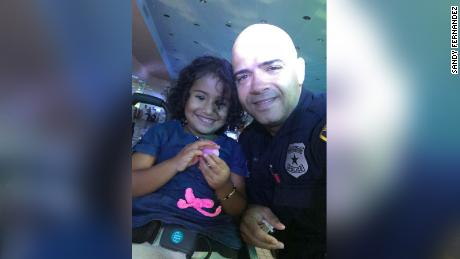 Houston Police Officer Sandy Fernandez with his young dance partner.