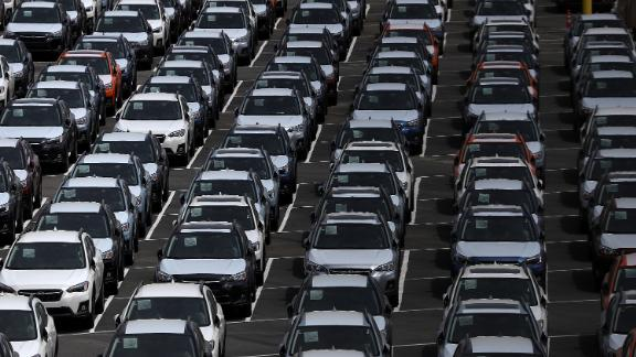 Brand new cars sit in a lot at the Auto Warehousing Company near the Port of Richmond on May 24 in Richmond, California.
