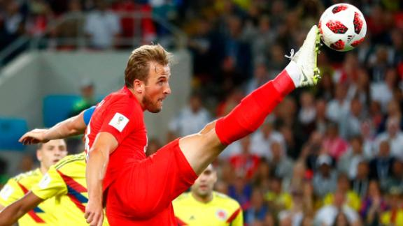 England's Harry Kane tries to control the ball against Colombia. He scored a penalty during regulation time. It was his tournament-leading sixth goal.