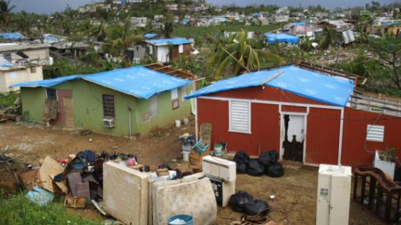SAN ISIDRO, PUERTO RICO - OCTOBER 15:  Uncollected debris stand near damaged homes in an area without electricity on October 15, 2017 in San Isidro, Puerto Rico. Puerto Rico is suffering shortages of food and water in many areas and only 15 percent of grid electricity has been restored. Puerto Rico experienced widespread damage including most of the electrical, gas and water grid as well as agriculture after Hurricane Maria, a category 4 hurricane, swept through.  (Photo by Mario Tama/Getty Images)