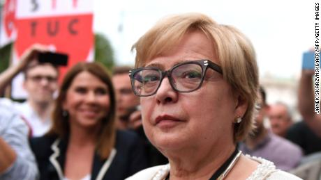Polish Supreme Court Justice Malgorzata Gersdorf (C) attends a demonstration in support of Supreme Court judges in front of The Supreme Court in Warsaw on July 3, 2018. - Poland's chief justice refused to step down, defying a controversial new law by the right-wing government which requires her and other senior judges to retire early. (Photo by Janek SKARZYNSKI / AFP)        (Photo credit should read JANEK SKARZYNSKI/AFP/Getty Images)