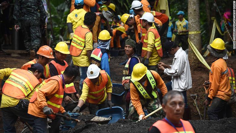 Workers fix the road leading to the Tham Luang Nang Non cave system after the team was found alive.