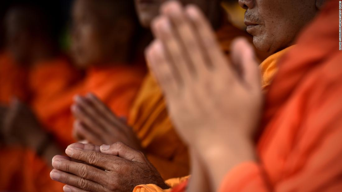 Monks attend a Buddhist prayer for the team on July 1.