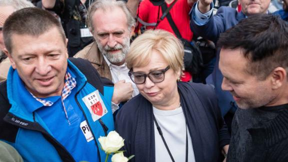 Polish Supreme Court Justice president Malgorzata Gersdorf, center, arrives for work Wednesday at the Supreme Court building in Warsaw as people gather to support her.