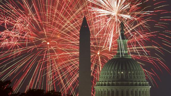 TOPSHOT - Fireworks explode over the National Mall as the US Capitol (R) and National Monument are seen on July 4, 2017, in Washington, DC. / AFP PHOTO / PAUL J. RICHARDS        (Photo credit should read PAUL J. RICHARDS/AFP/Getty Images)