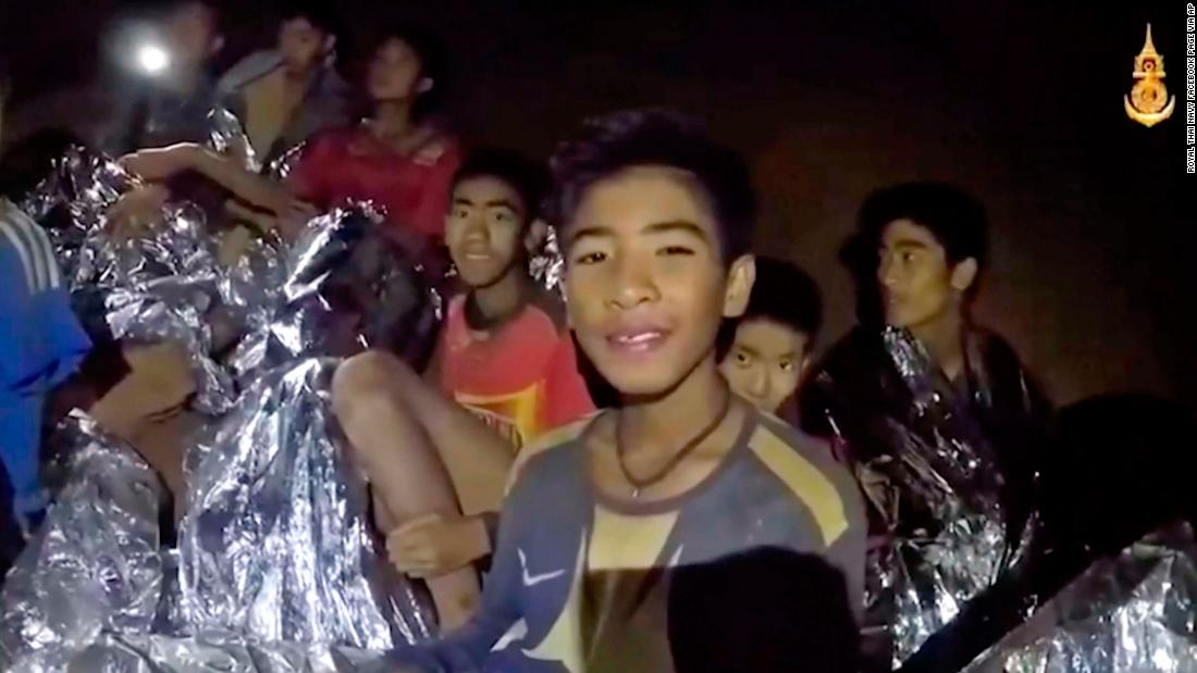 The boys in the cave receive medical attention in this image that was taken from video last week. All of them have since been rescued.