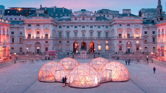 "To highlight the global air pollution problem, British artist Michael Pinsky reproduced the air quality of five different locations in a series of inter-connected ""Pollution Pods."""