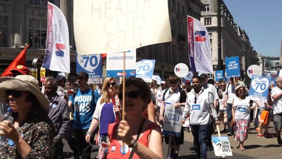 The NHS Anti-Swindle Team marched to mark NHS' 70th anniversary.