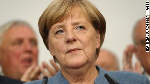 Angela Merkel's Bavarian allies lose majority in crushing vote