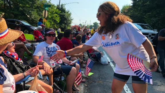 Democratic candidate Lucy McBath greets potential voters at an Independence Day parade.