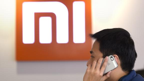 This picture taken on January 7, 2015 shows a man using his mobile phone at a Xiaomi shop in Beijing.    AFP PHOTO / WANG ZHAO / AFP / WANG ZHAO        (Photo credit should read WANG ZHAO/AFP/Getty Images)