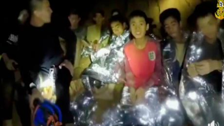 The Thai boys with Navy SEALs inside the cave on Tuesday.