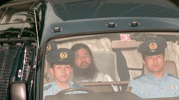 Shoko Asahara, head of the doomsday cult Aum Shinrikyo, is transferred from Tokyo police headquarters to Tokyo District Court for questioning in July 1995.