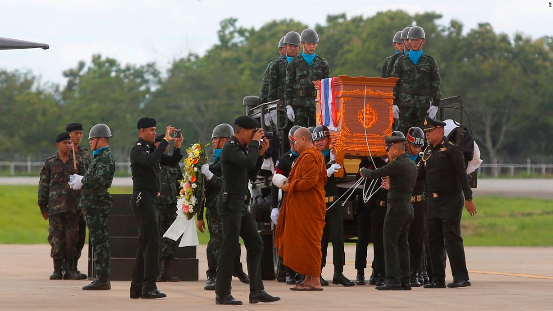 The body of Saman Kunan, a former Thai Navy SEAL, is carried during a repatriation and religious rites ceremony on Friday, July 6. Kunan died at 2 a.m. Friday as he returned from an operation to deliver oxygen tanks to the cave. He ran out of air while underwater, an official said.