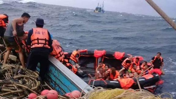 Thai rescue personnel respond to the scene off the coast of Phuket.