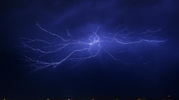LAS VEGAS, NV - JULY 07:  Lightning strikes during a thunderstorm on July 7, 2015 in Las Vegas, Nevada. The monsoon storm dropped heavy rain and hail in parts of the valley causing street flooding and power outages.  (Photo by Ethan Miller/Getty Images)