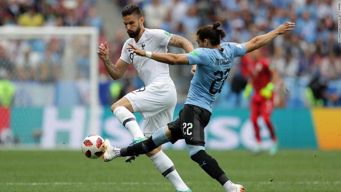 France's Olivier Giroud, left, and Uruguay's Martin Caceres battle for the ball during their quarterfinal match on July 6. France won 2-0.