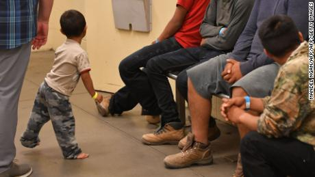 Young migrant children, whose faces can not be shown, are seen at the US Customs and Border Protection Facility in Tucson, Arizona during a visit by US First Lady Melania Trump, June 28, 2018. (Photo by MANDEL NGAN / AFP)        (Photo credit should read MANDEL NGAN/AFP/Getty Images)