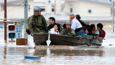 Japanese military personnel evacuate residents in Kurashiki, Okayama prefecture.