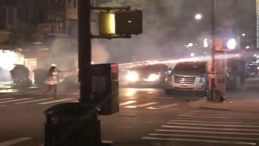 Woman shoots fireworks at people on street