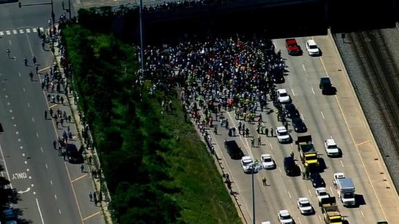 Before police relented, protesters gatherered Saturday on part of northbound I-94 on Chicago's South Side, while officers tried to keep part of it open.