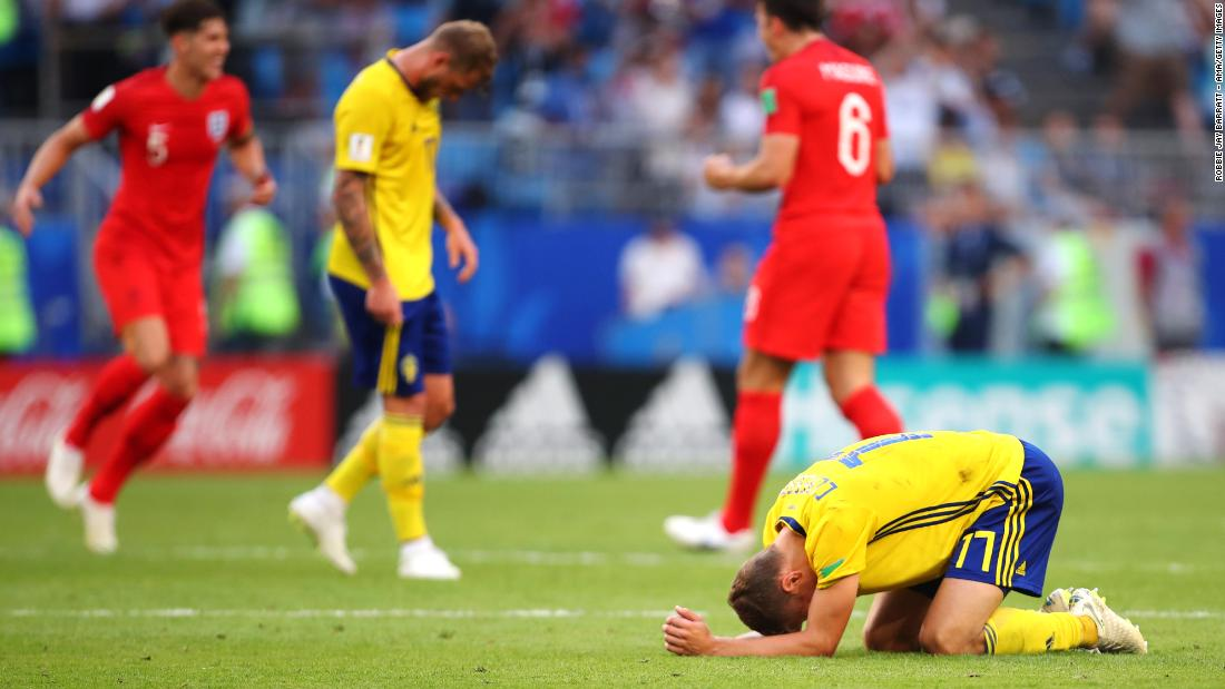 Swedish players are dejected at the end of the match.