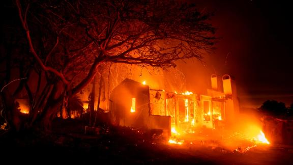 Flames consume a home on N. Fairview Ave. as the Holiday fire burns in Goleta, Calif., on Saturday, July 7, 2018. The blaze has destroyed multiple homes. (AP Photo/Noah Berger)