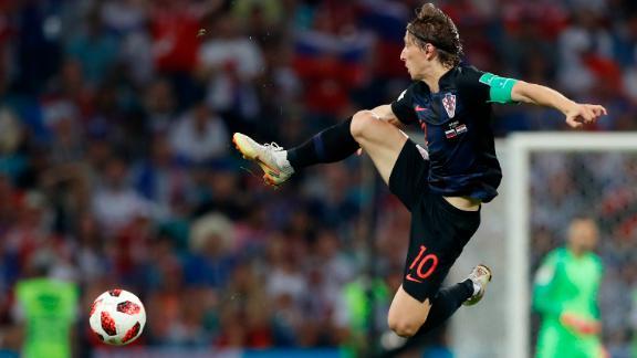 Luka Modric jumps for the ball during Croatia