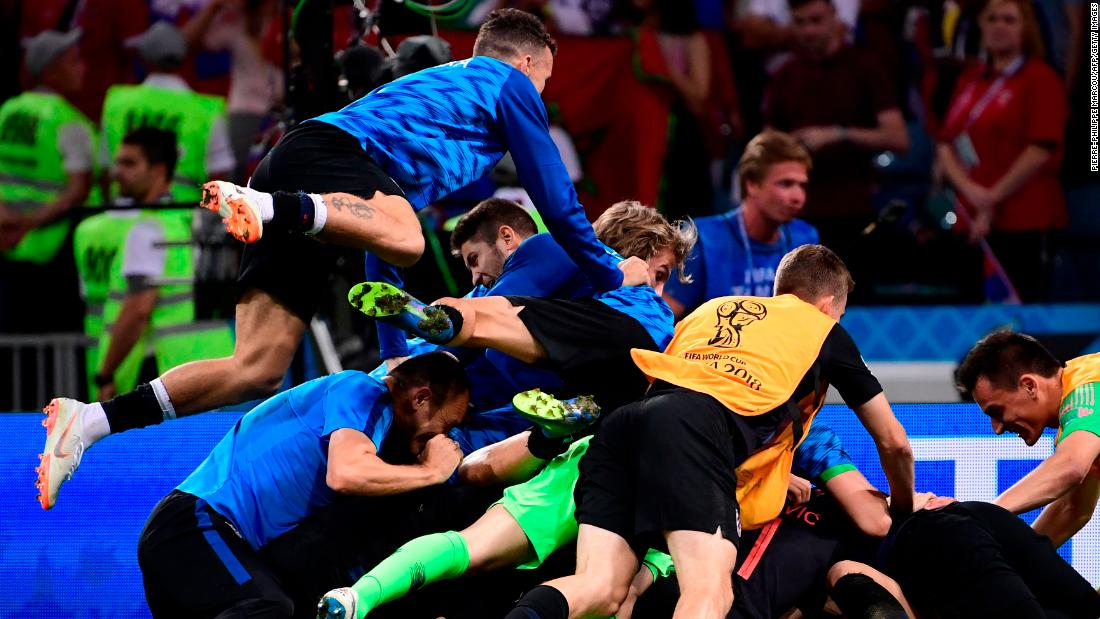 Croatian players celebrate after defeating Russia in a penalty shootout. The match was tied 2-2 after extra time.