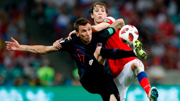 Croatia's Mario Mandzukic, left, and Russia's Mario Fernandes go for the ball.