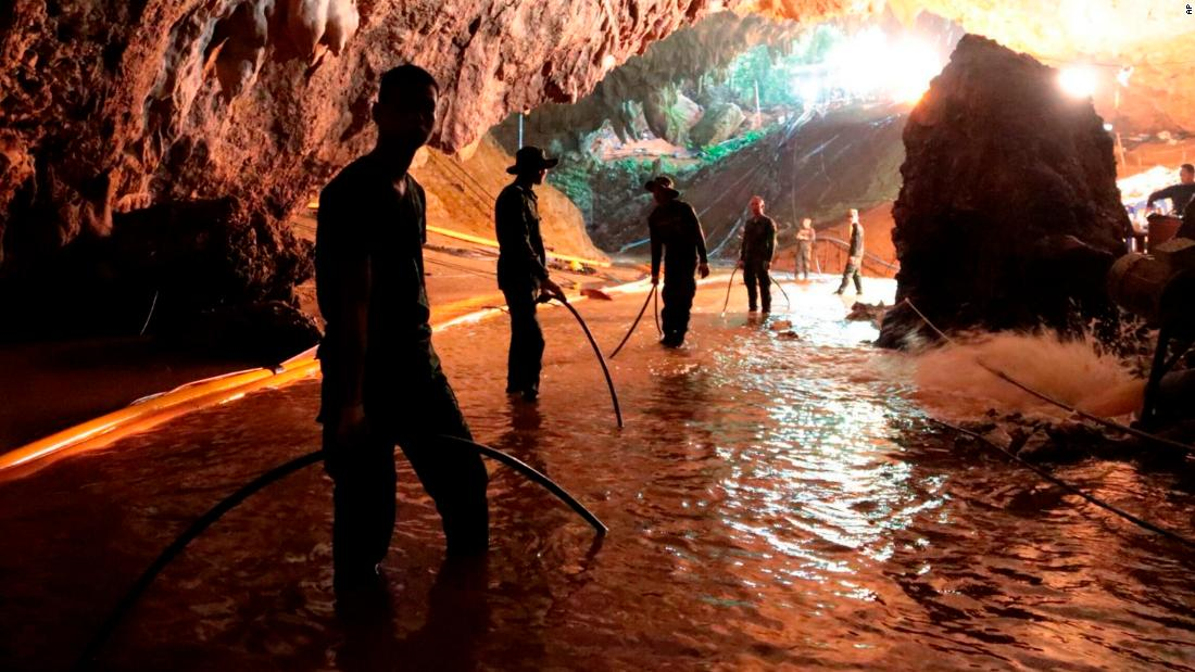 Thai rescue teams arrange a water pumping system at the entrance to a flooded cave complex where 12 boys and their soccer coach became trapped June 23 in Mae Sai, Chiang Rai province, northern Thailand, on Saturday, July 7, 2018.