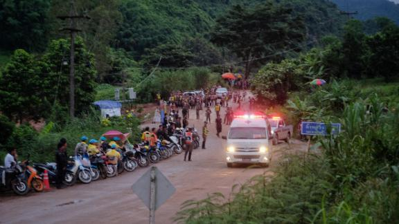 An ambulance leaves the Tham Luang cave area after divers evacuated some of the 12 boys trapped with their coach for 15 days.