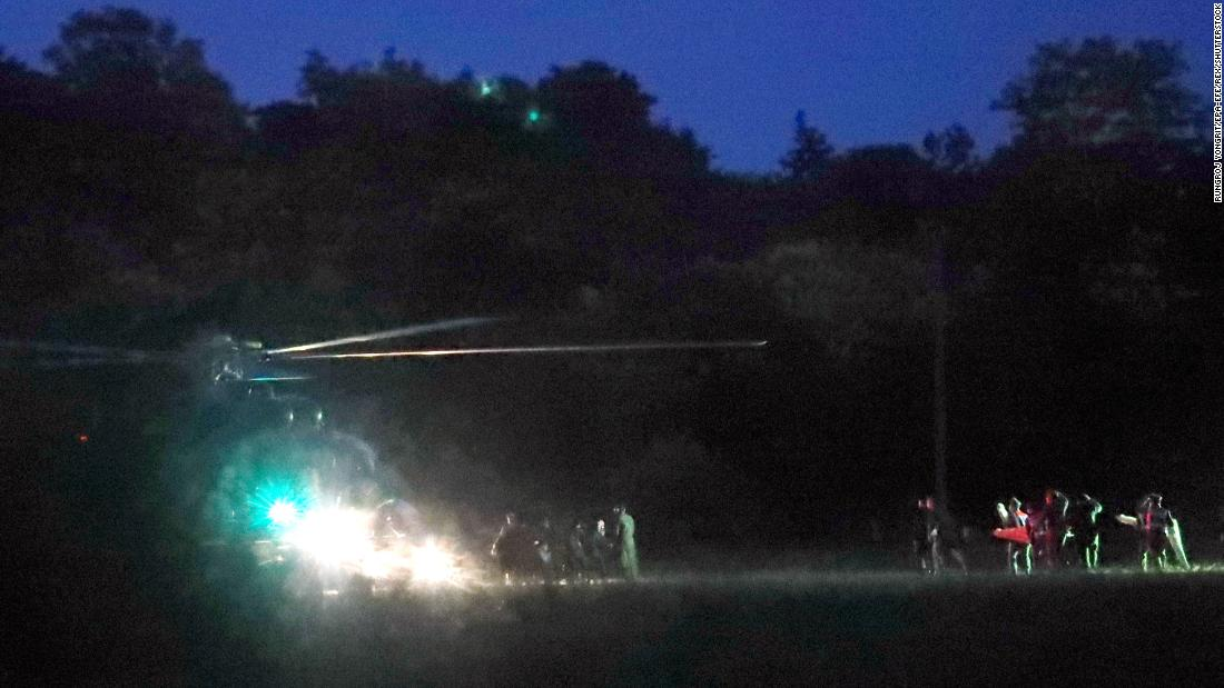 Emergency responders surround a helicopter prior to departing for the hospital on Sunday, July 8, after members of the soccer team had been rescued.