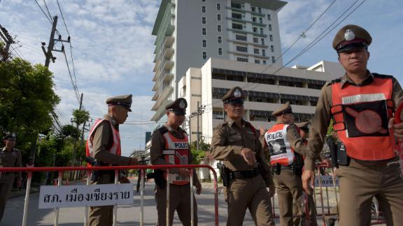 Thai policemen block a road leading to the hospital where the rescued boys are recovering.