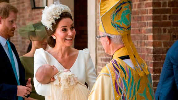 The Duchess of Cambridge speaks to Archbishop of Canterbury Justin Welby as she arrives carrying Prince Louis for his christening service.